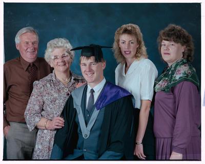 Negative: Mr Grave Graduate And Family
