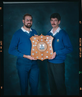 Negative: Two Men With Trophy Shield