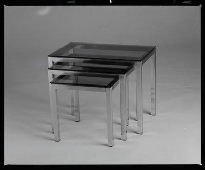 Negative: Brass And Glass Tables