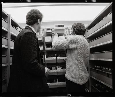 Negative: Two Men In Pro-Ed Storeroom