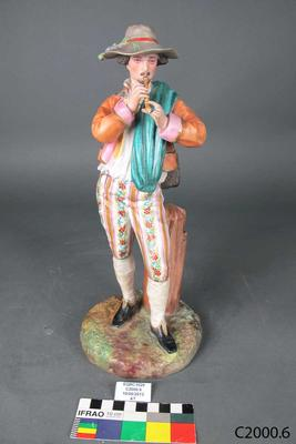 Figurine: Man Playing Flute