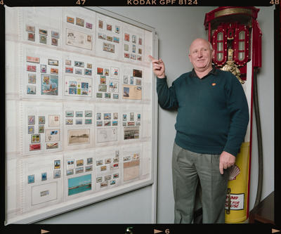 Negative: Man With Stamp Collection