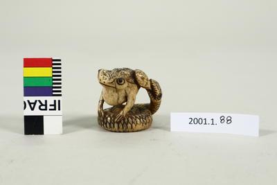 Netsuke snake eating toad
