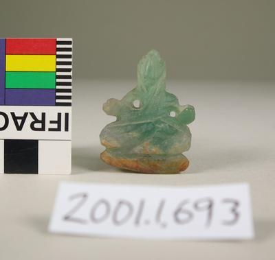 Green small Buddhist figure
