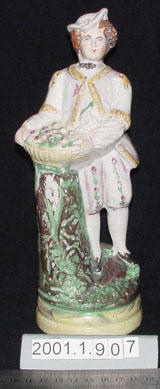 Figurine of a man with basket