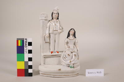 Figurine man and woman in white