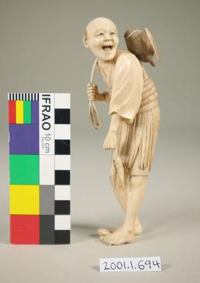 Figurine of a fisherman