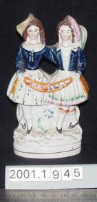 Figurine of girl and boy