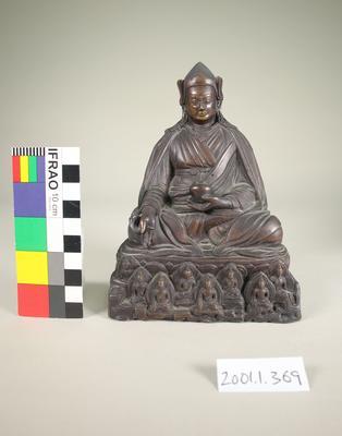Aged brass figurine