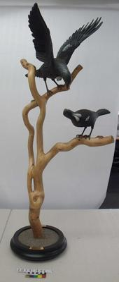 """The Tuis"" wood sculpture"