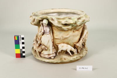Relief sculpted ceramic pot