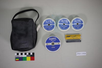 Fishing lines and hook sharpening stone in bag