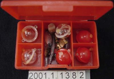 Fishing accessories in container
