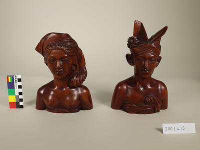 Carved heads of man and woman