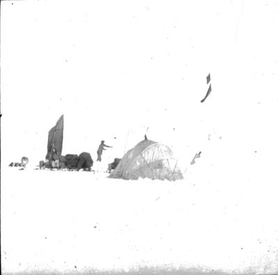 Lantern slide: Sledge with sail, tent and flagged cairn, Imperial Trans-Antarctic expedition