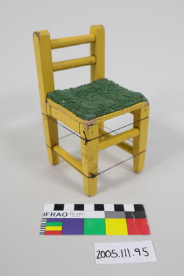 Prop: Yellow painted wooden chair