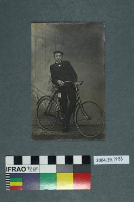 Postcard: Man with bike