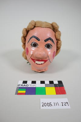 Prop: Paper mache female head with exposed teeth