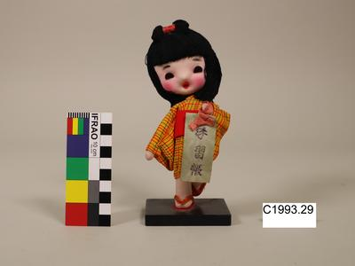 Doll on stand