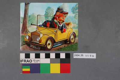 Postcard: Basil Brush puppet in a yellow car