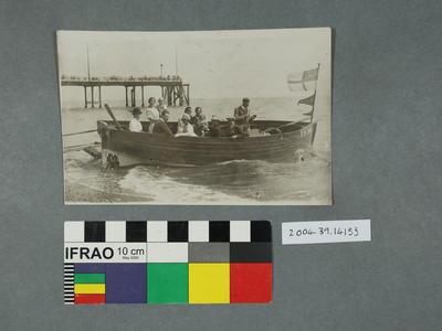 Postcard: People in a boat scene