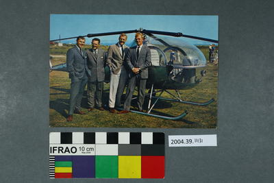Postcard of four men and a helicopter