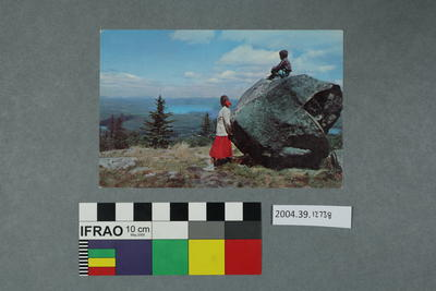 Postcard: Two people and a large rock