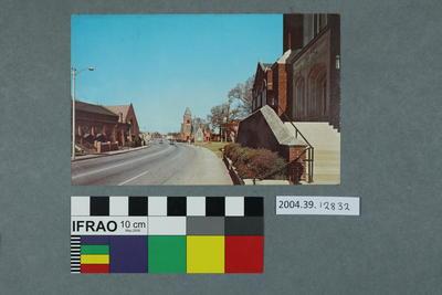 Postcard: Street view and church scene
