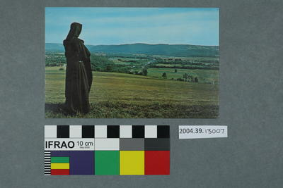 Postcard of a nun and a view