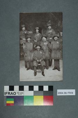 Postcard of seven men