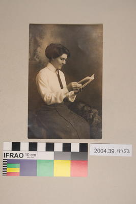 Postcard of a woman reading