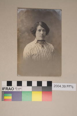Postcard of a woman in striped shirt
