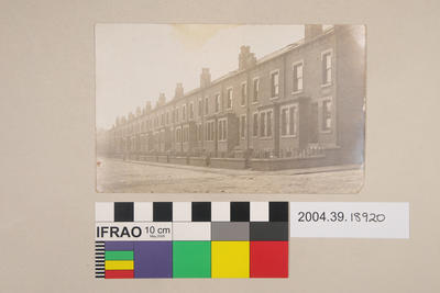 Postcard of a row of brick houses
