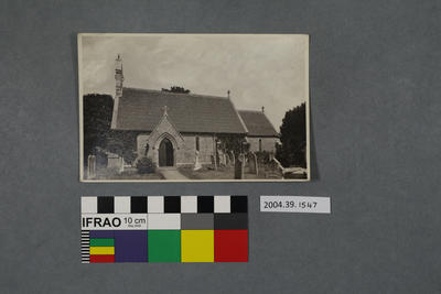 Postcard of the side of a church and graveyard