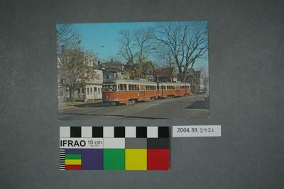 Postcard of two orange trams