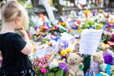 Photograph: Girl and Tributes