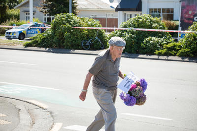 Photograph: Man with Flowers