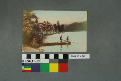 Postcard of two people on a boat