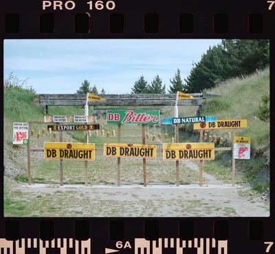 Negative: Beer Signs At Shooting Range