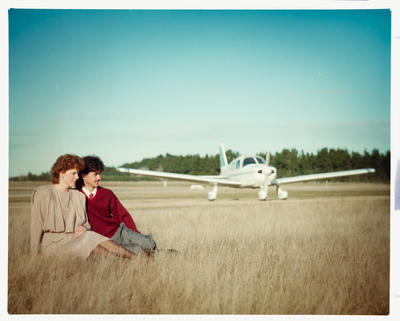 Negative: Man And Woman With Plane