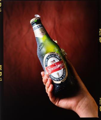 Negative: Hand Holding Steinlager Bottle