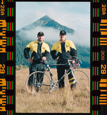 Negative: Two Men With Bicycle Coast To Coast