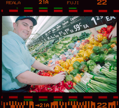 Negative: Man In Supermarket Produce Section