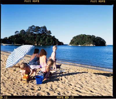 Transparency: Family On Kaiteriteri Beach