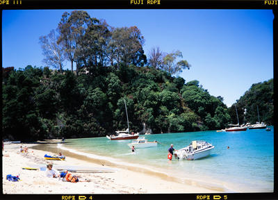 Transparency: People And Boats At Kaiteriteri Beach