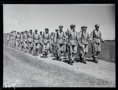 Glass negative: K Force, soldiers marching