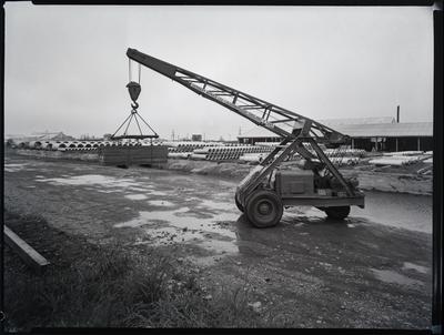 Film Negative: Morris Mobile crane in pipe storage yard