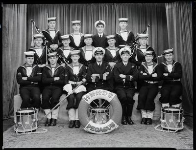 Black and White Film Negative: HMNZS Pegasus, pipe band