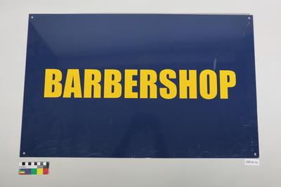 Former USN sign (Barbershop)