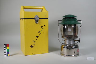 Coleman tilley lamp in carry box.